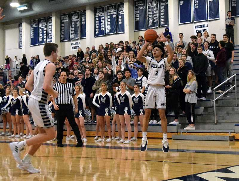 SPOKESMAN PHOTO: TANNER RUSS - Wilsonville senior Zach Rivers nails the long '3' against Crescent Valley.