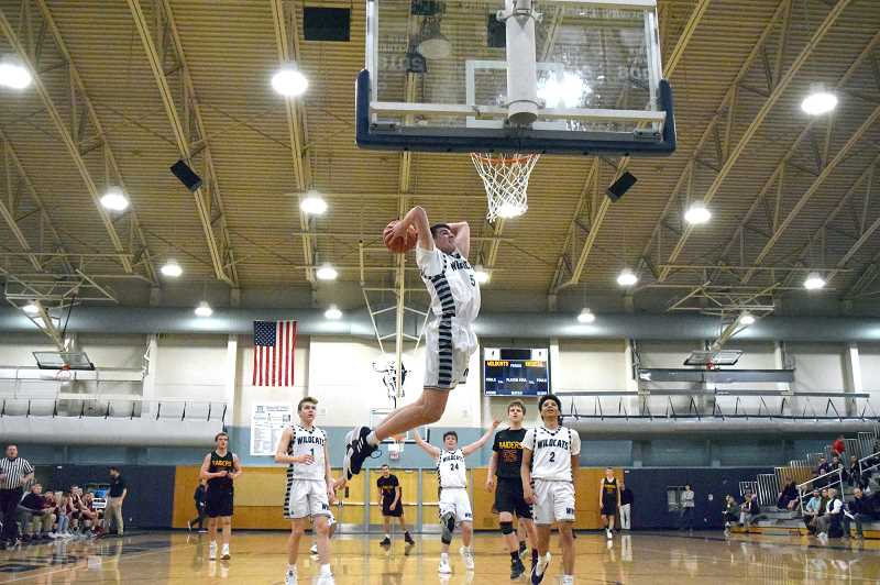 SPOKESMAN PHOTO: TANNER RUSS - Junior Dakota Reber dropped a pair of dunks against the visiting Crescent Valley Raiders in the lopsided win.