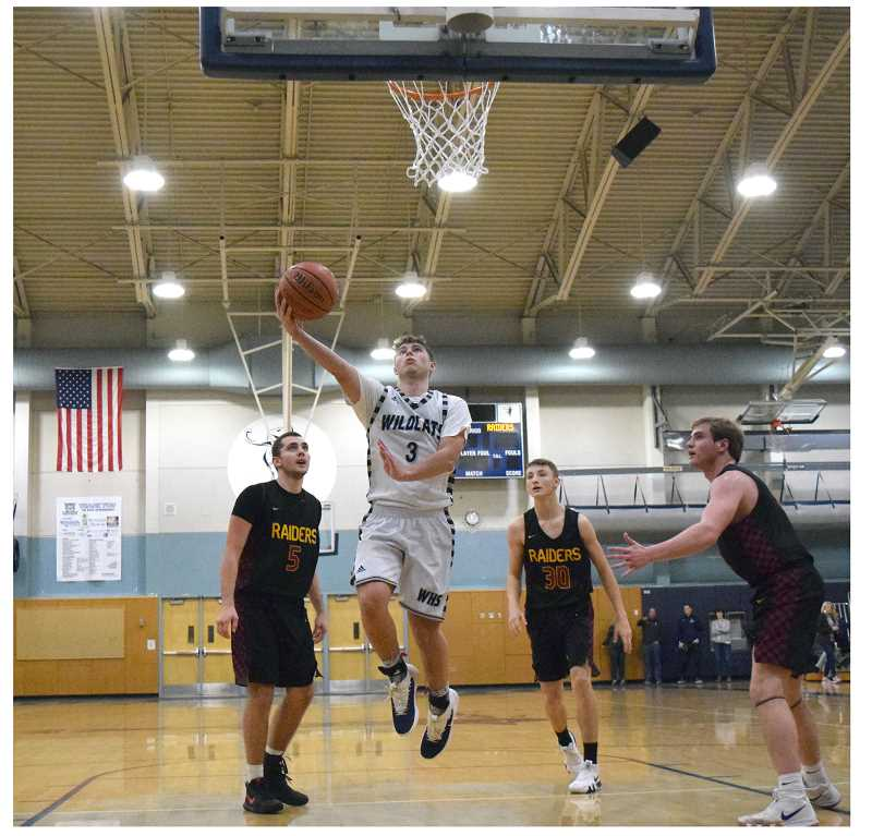 SPOKESMAN PHOTO: TANNER RUSS - Senior Jack Roche led the team in scoring with 19 points against Crescent Valley.
