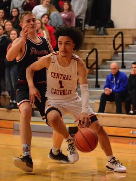 PMG PHOTO: DAVID BALL - Central Catholics Tyson Parker drives the baseline during the first half of the Rams home win Friday.