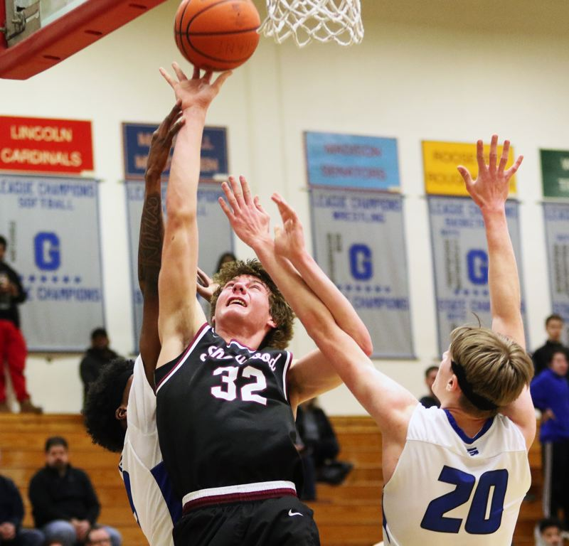 PMG PHOTO: DAN BROOD - Sherwood High School junior Blake Jensen puts up a shot near the basket during the Bowmen's state playoff game with Grant.
