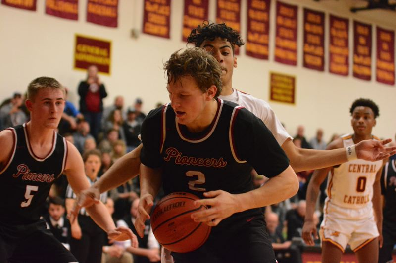 PMG PHOTO: DAVID BALL - Sandys Colby Carson comes down with a rebound in the second half of the Pioneers 66-43 playoff loss at Central Catholic on Friday.