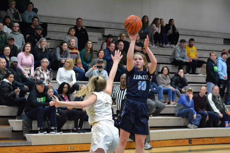 PMG PHOTO: MATT SINGLEDECKER - Liberty's LIvia Knapp pulls up for a jumpshot during the Falcons' game against Jesuit Saturday, March 2, at Jesuit High School.
