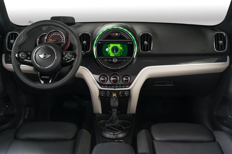 BMW OF NORTH AMERICA - All the trademark Mini Cooper touches are included in the 2019 Countryman PHEV, including the round center screen and multiple  toggle switches.