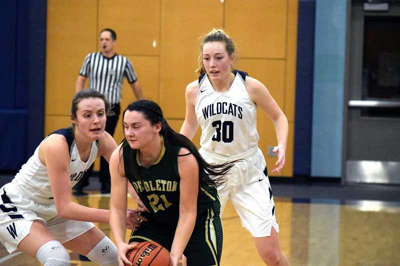 SPOKESMAN PHOTO: TANNER RUSS - Wilsonville junior Kayla Hieb and senior Cydney Gutridge defend against the Pendleton offense.