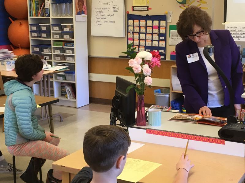 PMG PHOTO: PETER WONG - U.S. Rep. Suzanne Bonamici, D-Ore., reads aloud from 'I Am Soto Sotomayor' during Read Across America Day on Friday in the 5th grade class of Suzanne Smith at Maplewood Elementary School in Portland.