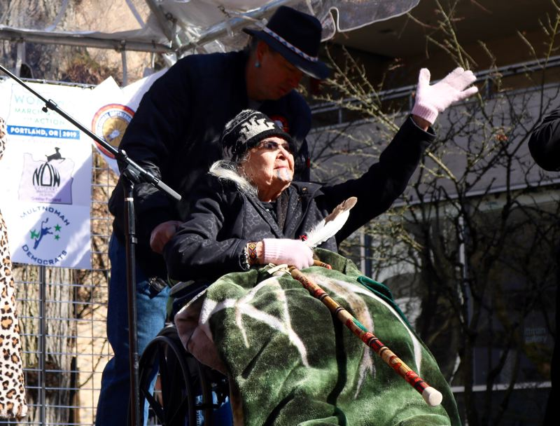 TRIBUNE PHOTO: ZANE SPARLING - Spiritual leader and Takelma elder Agnes 'Grandma Aggie' Baker Pilgrim waves to the crowd during the Womxn's March on Sunday, March 3 in Portland.