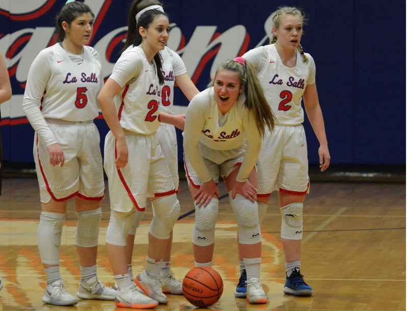 PMG PHOTO: DAVID BALL - La Salle Prep players move to the sideline during a first-half timeout in its 69-15 playoff win over North Bend on Saturday.