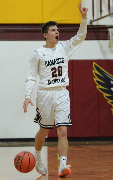 PMG PHOTO: DAVID BALL - Damascus Christian point guard Johnny Shields scored 14 points in the Eagles 59-52 win over Sherman in Saturdays fourth-place game in Baker City.