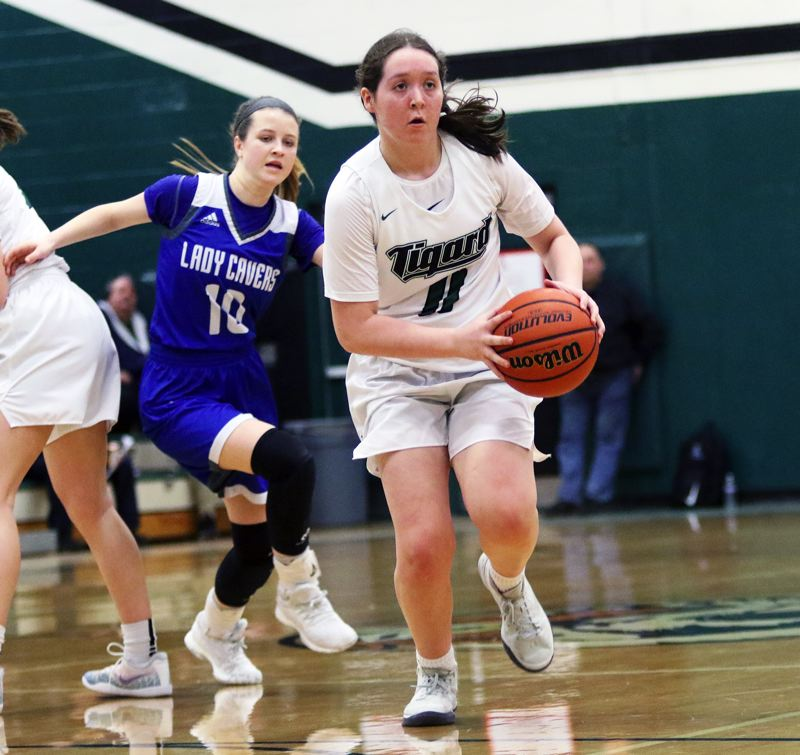 PMG PHOTO: DAN BROOD - Tigard High School senior guard Paige LaFountain looks to make a pass during the Tigers' state playoff win over Grants Pass on Saturday.