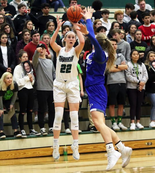 PMG PHOTO: DAN BROOD - Tigard High School junior Delaney Leavitt puts up a jump shot during the Tigers' state playoff victory over Grants Pass.