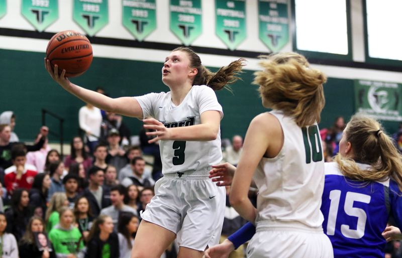 PMG PHOTO: DAN BROOD - Tigard High School senior Campbell Gray (3) puts up a scoop shot during the Tigers' win over Grants Pass on Saturday.
