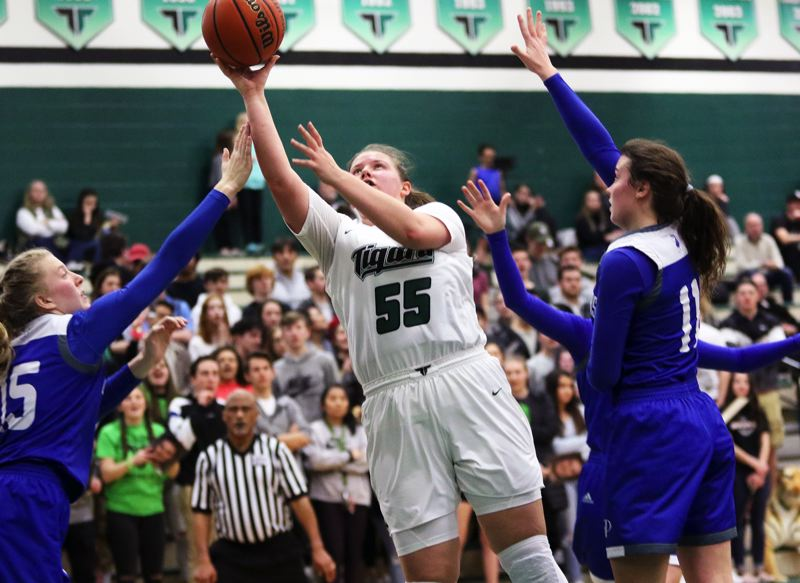 PMG PHOTO: DAN BROOD - Tigard High School senior Dani Lyons puts up a shot during the Tigers' state playoff win over Grants Pass on Saturday.