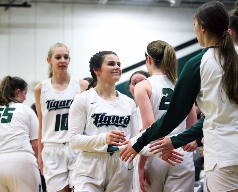 PMG PHOTO: DAN BROOD - Tigard High School junior Kennedy Brown smiles as she comes to the bench during the fourth quarter of Saturday's Class 6A state playoff game.