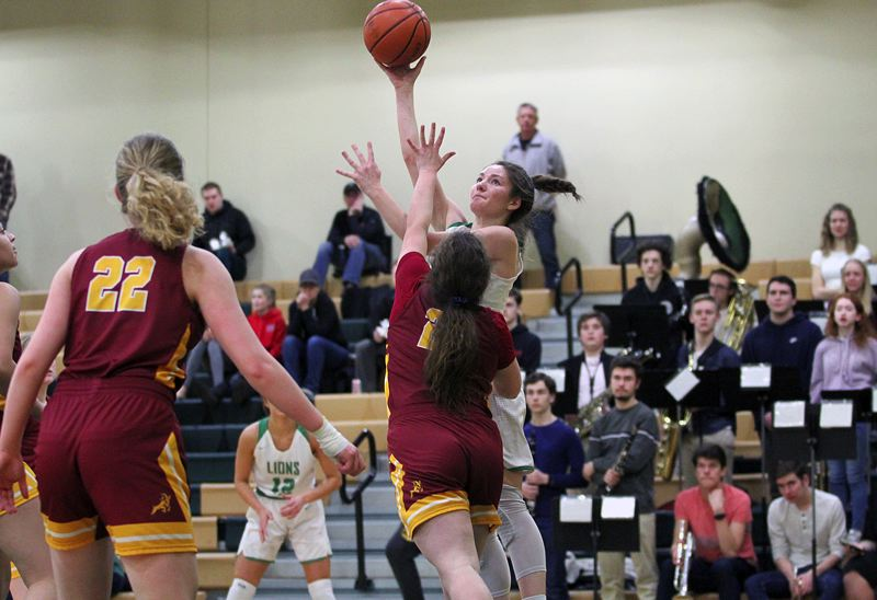 PMG PHOTO: MILES VANCE - West Linn junior Elisabeth Dombrow goes up for a one-handed shot during her team's 50-40 win over Central Catholic in the second round of the Class 6A state playoffs on Saturday at West Linn High School.