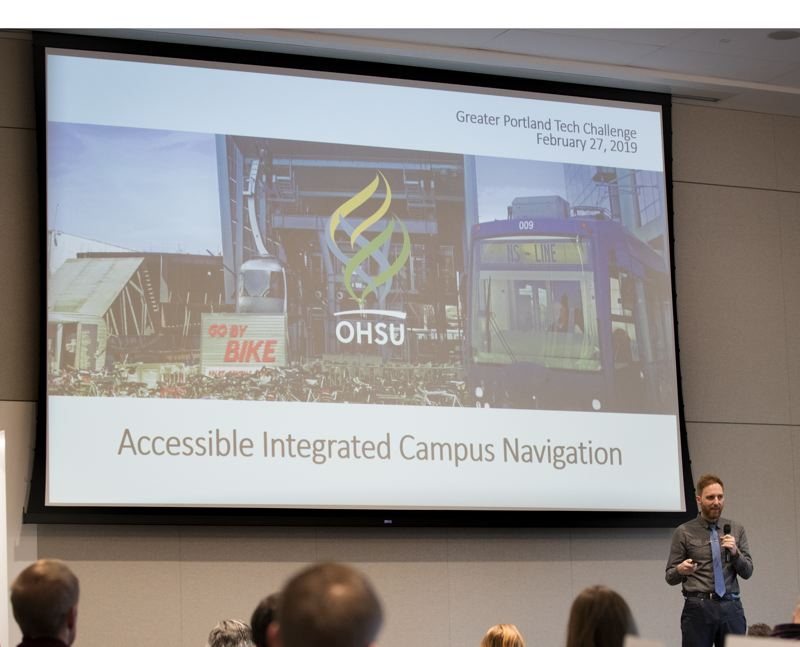 PMG PHOTO: JAIME VALDEZ - John Landolfe of OHSU talks about how the campus is hard to navigate and needs some kind of smart trip planner.