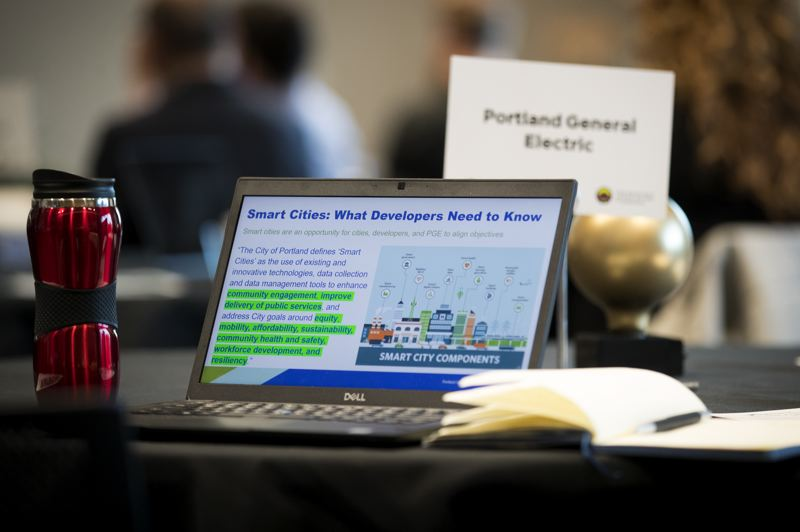 PMG PHOTO: JAIME VALDEZ - Food for thought: An attendees laptop shows the Greater Portland Tech Challenge website.