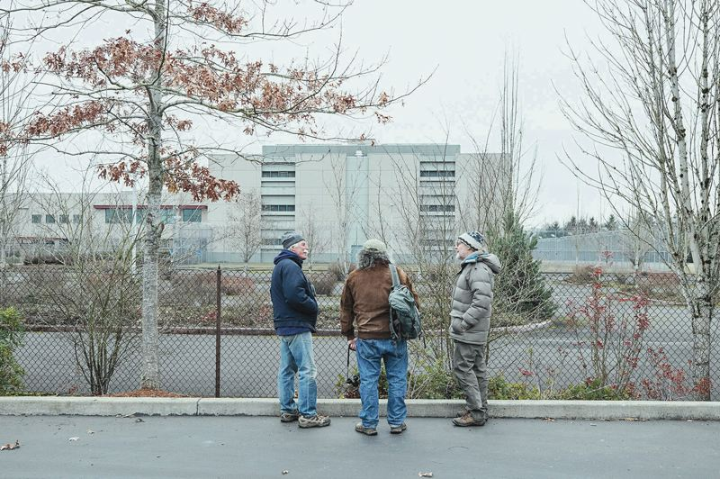 PORTLAND TRIBUNE: JONATHAN HOUSE - From left, Troy Clark, Dale Svart and Bob Sallinger stand outside of Wapato. They hope that the owner will not cut down the trees that ring the property.