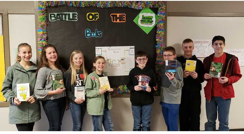 PHOTO SUBMITTED BY KRIS JONES  - The final two Crook County Middle School teams, the Killer Sprinkles and the Bookeneers, battle for the championship Tuesday. Pictured left to right, Kylie Merwin, Sawyer McDonald, Aubrie Olson, Dylanne Smith, Tanner Joyce, Aidan Bonner, Issac Freeman and Caiden Rosas.
