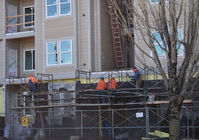 PMG PHOTO: MATT DEBOW - Construction crews work on an apartment complex in Fairview on Friday, March 1. House Bill 2001 aims to combat Oregons housing crises by requiring duplexes and triplexes in single-family housing zones.