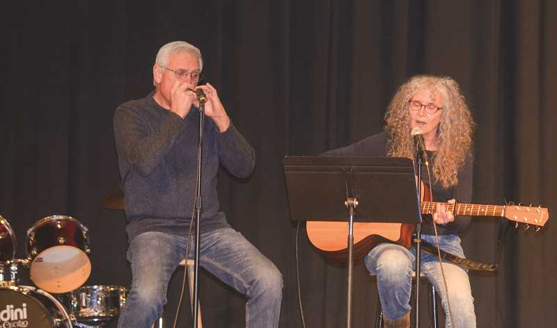 PHOTO SUBMITTED BY HEATHER FRASER - Wayne Bobbitt plays harmonica while Fran Rapport sings and plays guitar.