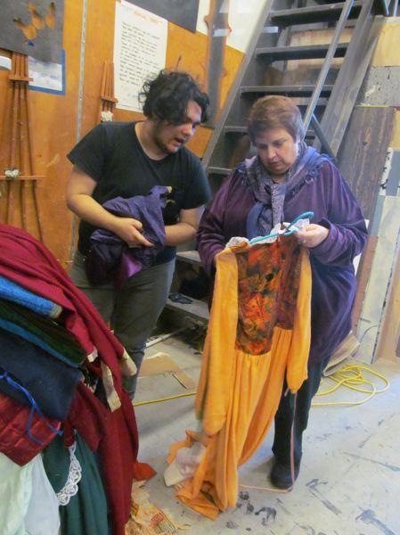 PHOTO BY ELLEN SPITALERI - Quinn Bicer, a senior at Clackamas High School, and Susan Scovil, director of 'A Company of Wayward Saints,' choose costumes for the play from the CHS costume department.