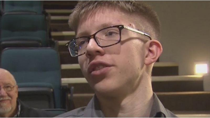 PHOTO COURTESY: KOIN 6 NEWS - Seth Skoien survived a cardiac event when the general manager of Dave & Busters at the Clackamas Town Center jumped in and did CPR in 2018. Both men were recognized on March 4 by Clackamas Fire.