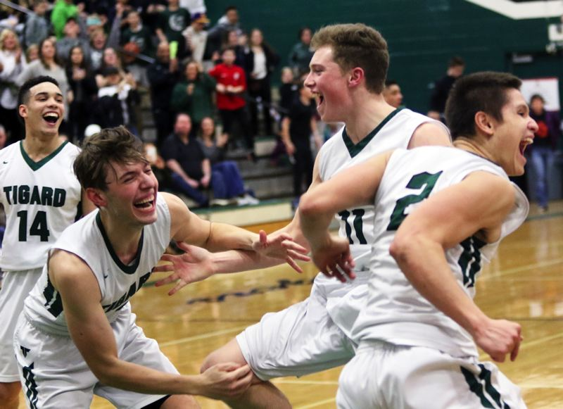 PMG PHOTO: DAN BROOD - Tigard's (from left) Max Lenzy, Diego Lopez, Eric Sawin and Jazz Ross celebrate following the Tigers' 85-74 win over Barlow in Saturday's Class 6A state playoff game.