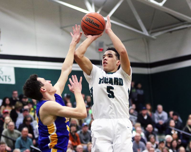 PMG PHOTO: DAN BROOD - Tigard High School sophomore Drew Carter goes up for a jumper, scoring the first two points, igniting a 13-0 run to start Saturday's state playoff game with Barlow.