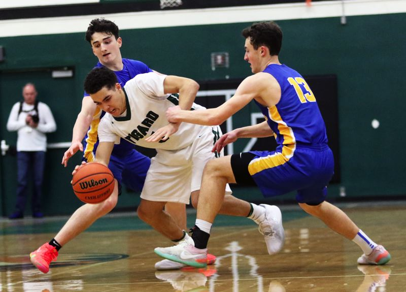 PMG PHOTO: DAN BROOD - Tigard sophomore Drew Carter tries to power his way past Barlow juniors Jesse White (left) and Evan Inglesby during Saturday's Class 6A state playoff game.