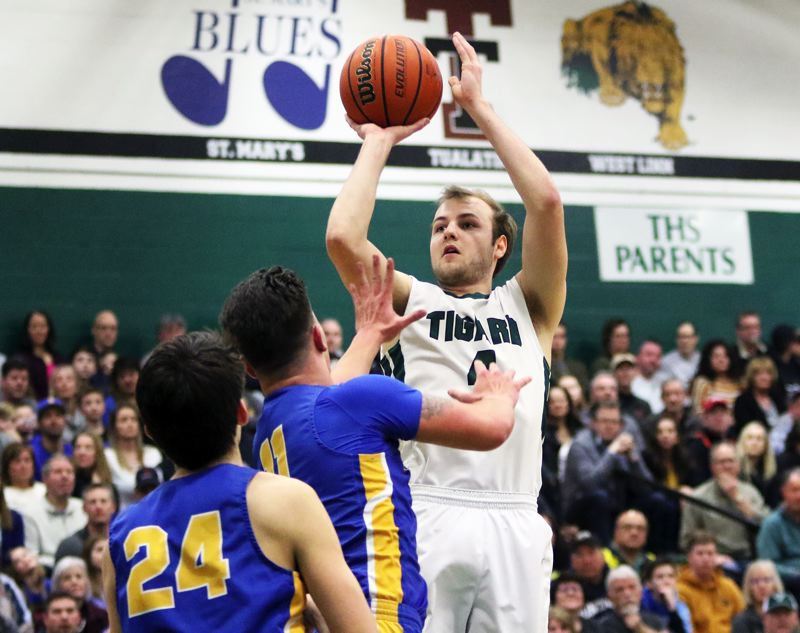 PMG PHOTO: DAN BROOD - Tigard High School senior Stevie Schlabach puts up a jump shot during the Tigers' 85-74 win over Barlow in Saturday's Class 6A state playoff game.
