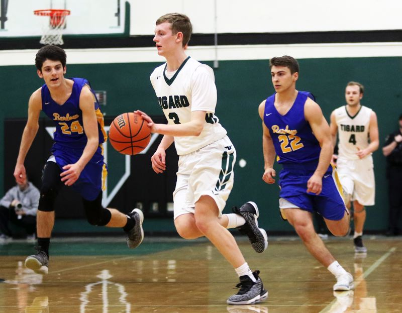 PMG PHOTO: DAN BROOD - Tigard High School senior guard Jake Bullard gets the ball up court during the Tigers' win over Barlow in Saturday's Class 6A state playoff game.