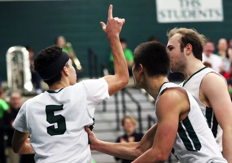 PMG PHOTO: DAN BROOD - Tigard's (from left) Drew Carter, Jazz Ross and Stevie Schlabach celebrate following Carter's fourth-quarter dunk during the Tigers' win over Barlow on Saturday.