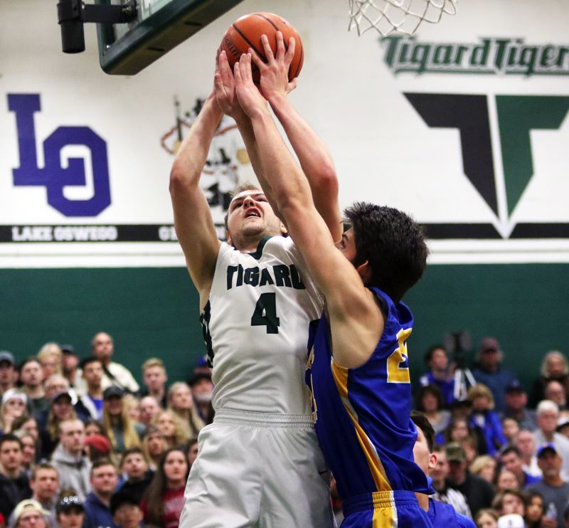 PMG PHOTO: DAN BROOD - Tigard High School senior Stevie Schlabach (4) looks to go up to the hoop during Saturday's state playoff game. Schlabach scored 36 points in the 85-74 win over Barlow.