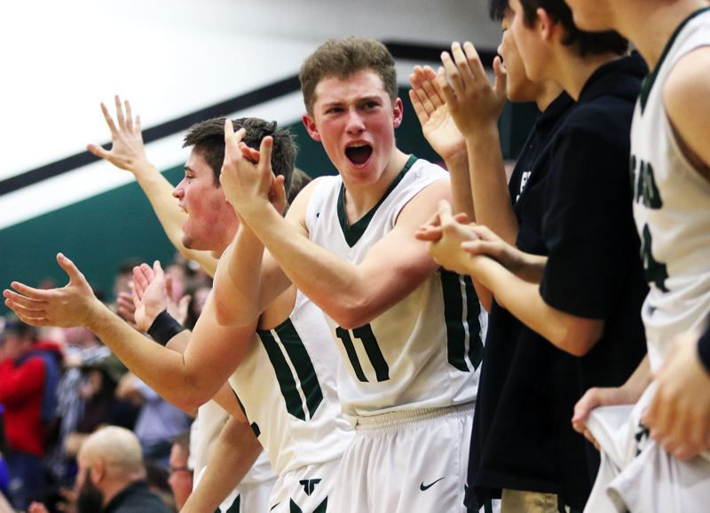 PMG PHOTO: DAN BROOD - Tigard seniors Carson Crist and Eric Sawin cheer on their teammates during the 85-74 state playoff win over Barlow on Saturday.