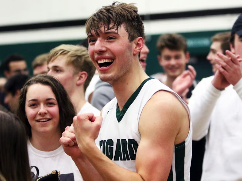 PMG PHOTO: DAN BROOD - Tigard High School senior Diego Lopez is all smiles following the Tigers' state playoff win over Barlow on Saturday.