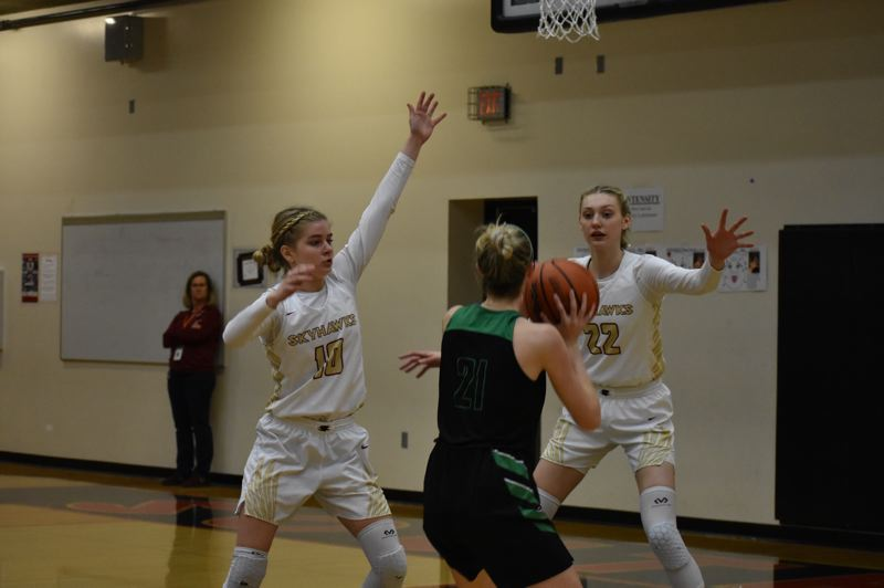 SUBMITTED PHOTO: LAUREN RUNNELS - Southridge junior point guard McKelle Meek, junior center Cameron Brink and the Skyhawks are head back to the Class 6A state tournament.