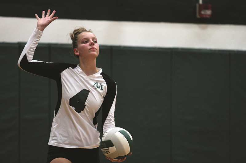 PMG PHOTO: PHIL HAWKINS - North Marion senior Emma Morcom earned First Team All-Conference honors for the Huskies this season, helping the volleyball program earn its first conference title since 1991.