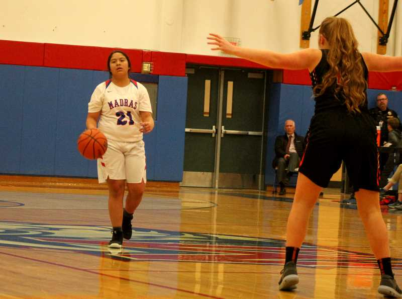 STEELE HAUGEN - Kalise Holliday dribbles the ball up the court. The Lady Buffs lost to Philomath 50-32 in the first round of the playoffs.