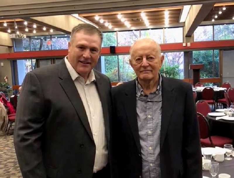 SUBMITTED PHOTO - Alley and head coach Bob Riehm meet up at the SOU Hall of Fame ceremony in November. The 1988 SOU team went 15-0 that season.