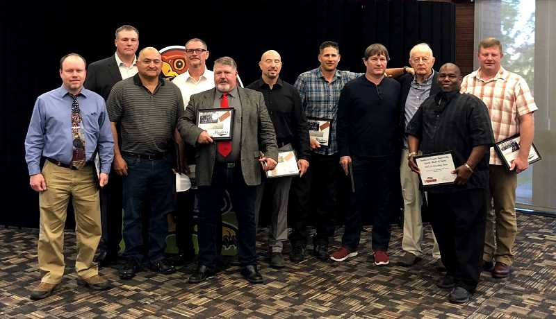 SUBMITTED PHOTO - The 1988 15-0 Southern Oregon wrestling team was inducted into the hall of fame in November.