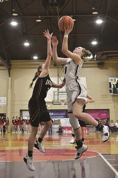 COURTESY: ANDRE PANSE - Kennedy senior Kalyssa Kleinschmit finished her high school basketball career with 18 points, six rebounds, four steals and three assists in the Trojans 49-31 win over Enterprise on Saturday.