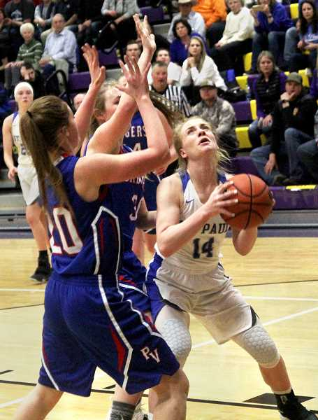 LA GRANDE OBSERVER PHOTO: RONALD BOND  - Junior Isabelle Wyss attacks the basket in St. Paul's championship win over Powder Valley on March 2.