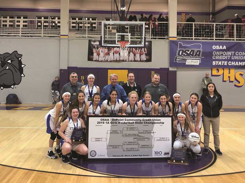 COURTESY: LES HILLER - The St. Paul girls basketball team celebrates winning the 2019 1A State Championship — the fifth state title for the program and the first undefeated season in school history.