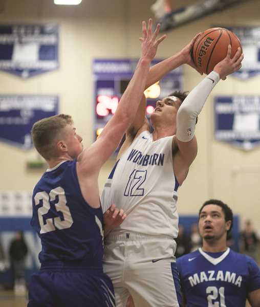 COURTESY: RICK VASQUEZ - Woodburn senior R.J. Veliz led the Bulldogs with 17 points in the teams 53-26 victory over Mazama on Friday.