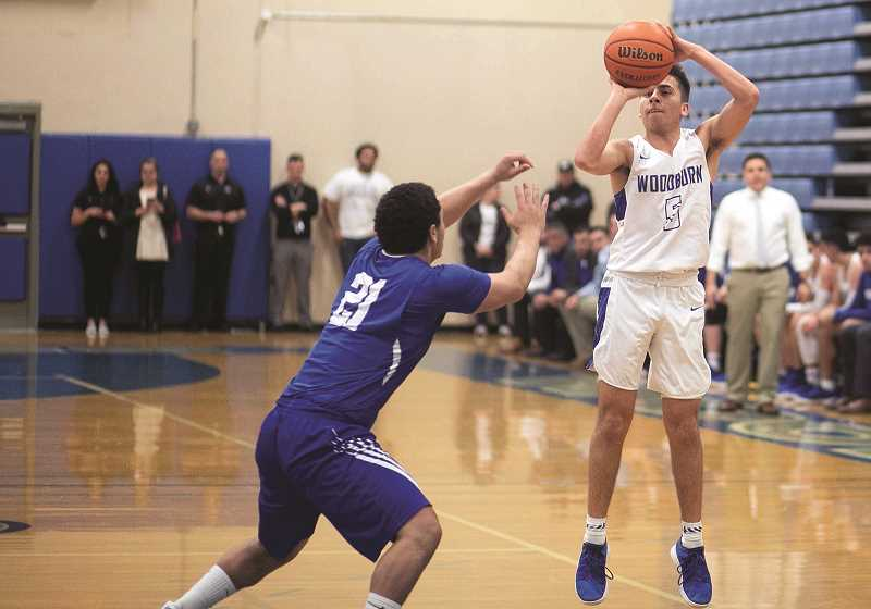 COURTESY: RICK VASQUEZ - Woodburn senior Diego Torres pulls up from 3-point range in the teams first-round win over Mazama, which put the Bulldogs back in the quarterfinals for the first time since 2011.