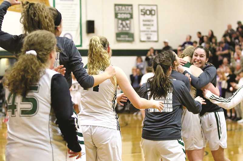 COURTESY: JO WHEAT - The North Marion girls basketball team celebrates its close call over Henley, pulling ahead in the final minute to win 48-45 on Saturday.