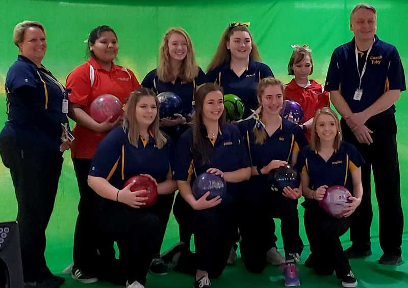 SUBMITTED PHOTO  - Anona Francis (back, second from left) and Zoya Hansen (back, second from right), Madras High School bowlers, in the red color uniforms, were combined with Bend High and won state on Feb. 22-23.