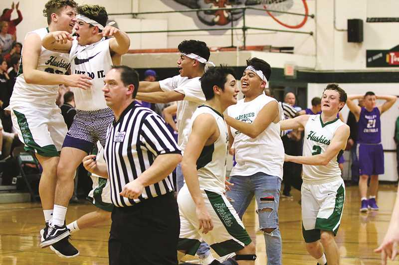 COURTESY: JO WHEAT - The North Marion boys basketball team celebrates its victory over Valley Catholic on Saturday, returning to the state quarterfinals for the first time since 2015.