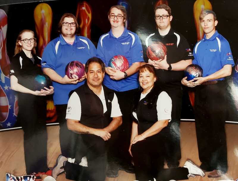 SUBMITTED PHOTO - Left to right, AJ Morgan (senior), Andrew Short, Reed Surber, Garrett Goelze (senior), Seth Baker, and coaches Kalani & Tami Kepa'a were this years Madras High School bowling team.